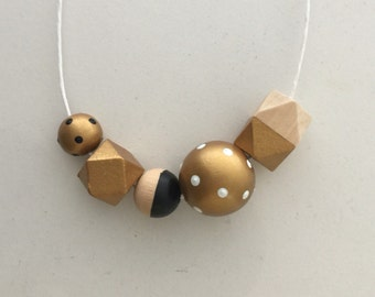 Wooden bead necklace // black and gold // hand painted