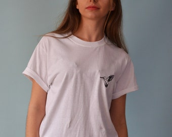 Hummingbird embroidered in black on white t-shirt