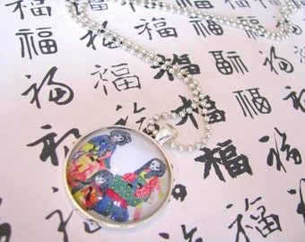 Japanese sisters glass-dome pendant necklace