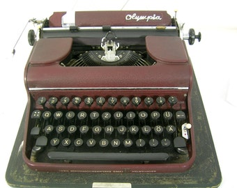 Very  beautiful portable typewriter in the boot 50 J., Olympia, Vintage