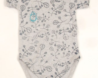 Organic cotton beetles and leaves babygrow.