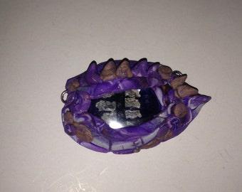 Purple dragon eye pendant