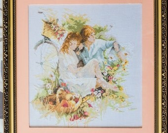Embroidered picture - A couple on a ride