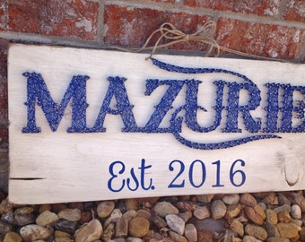 Family Name, nail wall art on painted and distressed wood sign