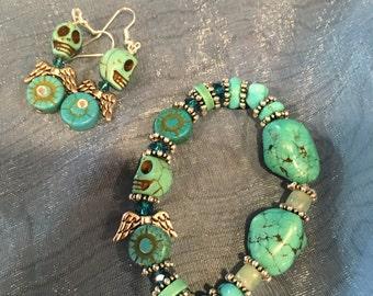 Teal sugar skull earrings and bracelet