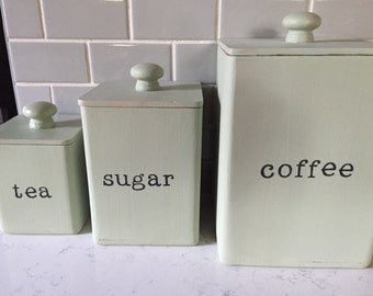 Vintage canisters, upcycled with chalk paint, permanent ink ( hand stamped), and sealant.