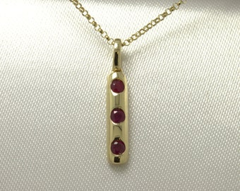 9ct yellow gold ladies 3 stone ruby ladies pendant