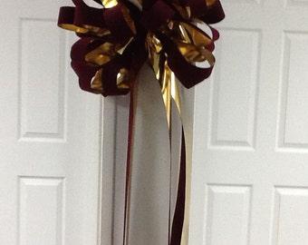 Burgundy and gold Christmas bow