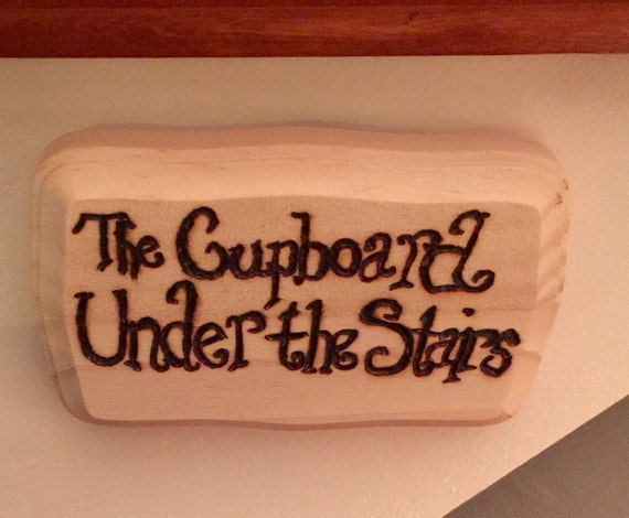 cupboard under the stairs sign 2