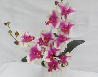 beautiful lifelike orchids and leaves in a white ceramic vase tropical flowers - Silk Orchids