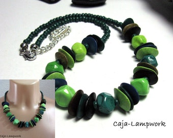 Green, short necklace made of handmade glass beads and ceramic beads,