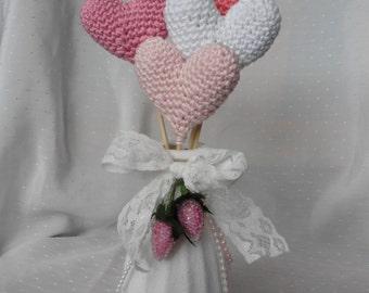 Crochet hearts in altered bottle