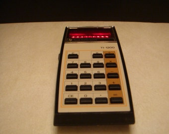 TI-1200 1970's calculator new in box