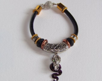 A totally unique Murano glass snake on a handcrafted  bracelet