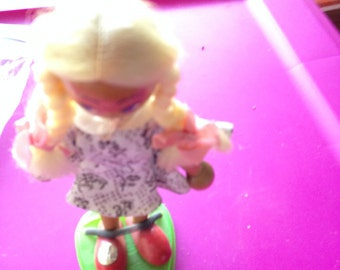 Vintage lovely mixture widen faced doll with long blond braids