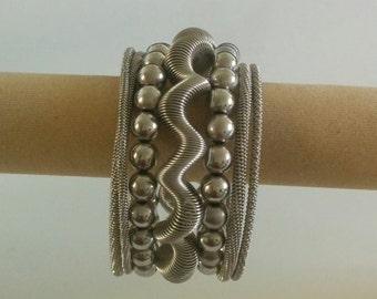 Off Silver / Grey Spiral Metallic 7 layer Bracelet