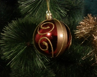 Vintage Christmas tree ornament.  Red and gold ball