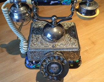 Old telephone dial vintage, old telephone antique roulette table in metal and cornet with fabric skull