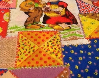 2 yards of Vintage Hummel-like, patchwork material.