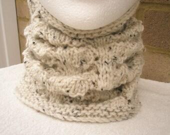 Cowl/neckwarmer.Beige with black/brown flecks.Hand knitted in soft aran yarn. lacy pattern.Ladies/teens.Winterwarm.Accessories.Style.
