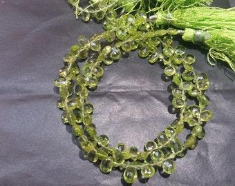 Peridot faceted Pear shape briolette , Green Natural Peridot pear .