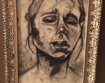 """Charcoal drawing titled """"Inner angst"""""""
