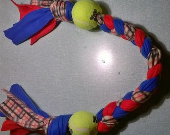 red  blue and checked plated tuggy with ball at each end diferent sizes