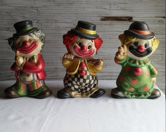 "Vintage 1985 Ceramic Clowns Signed E ZEN.  All are nicely painted by the Artist.  All are 7 1/2"" tall and 4 1/2"" at the feet.  Nice cond."