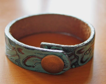 upcylced/recycled embossed and painted green leather cuff