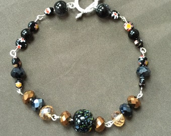 Black beaded bracelet with floral detail