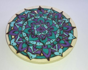 Pyrography coloured balsa wood mandala wall disc.