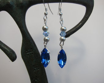 Silver earrings and blue tones swaroskis
