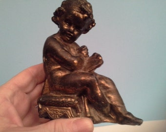 Copper metal sitting angel