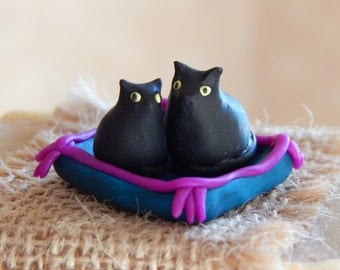 Miniature Cats on a Cushion