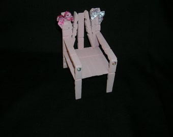 Wooden chairs made from clothes pegs.