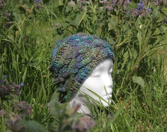Rainbow hat with cables knitted hand