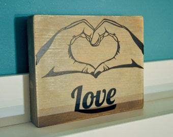 Love hands plaque