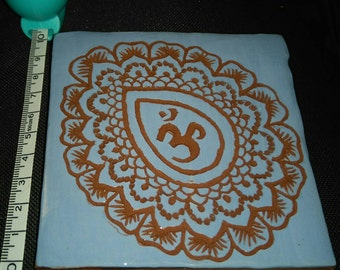 Blue terracotta tile with Om design