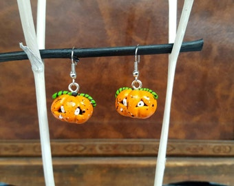 Jack O'Lantern earrings earrings with small pumpkins out of polymer clay in silver