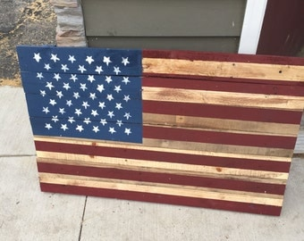 Wooden American Flag hand painted on reclaimed wood.
