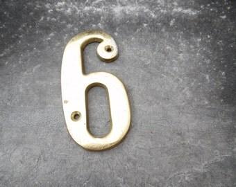 Vintage brass six or nine