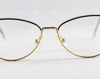 New old stock Vintage Ladies eyeglass frame Gold/Teal color Spring hinges Unique shape
