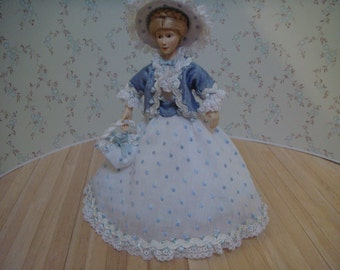 Period doll in her Sunday best, blue visiting dress.