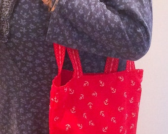 Red nautical yarn project bag and crochet hook wrap.