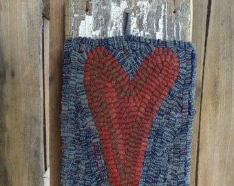 Primitive rug hooked heart wall hanging