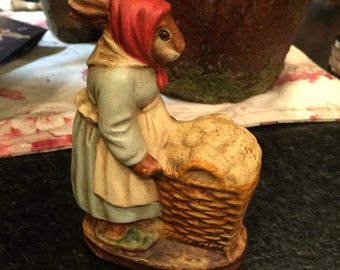 Primitive bunny with cart of eggs