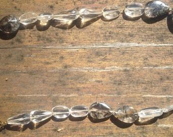 Rutilated quartz, and quartz beaded necklace