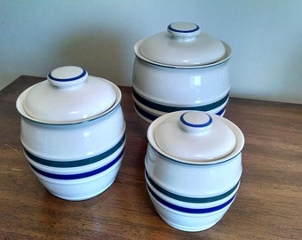 Vintage ceramic canisters striped with lids