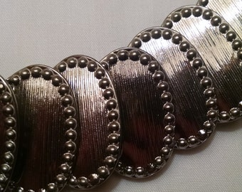 Metal stretch belt