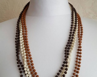Stunning Vintage 1960s 6 strand browns and cream plastic Beaded Necklace.